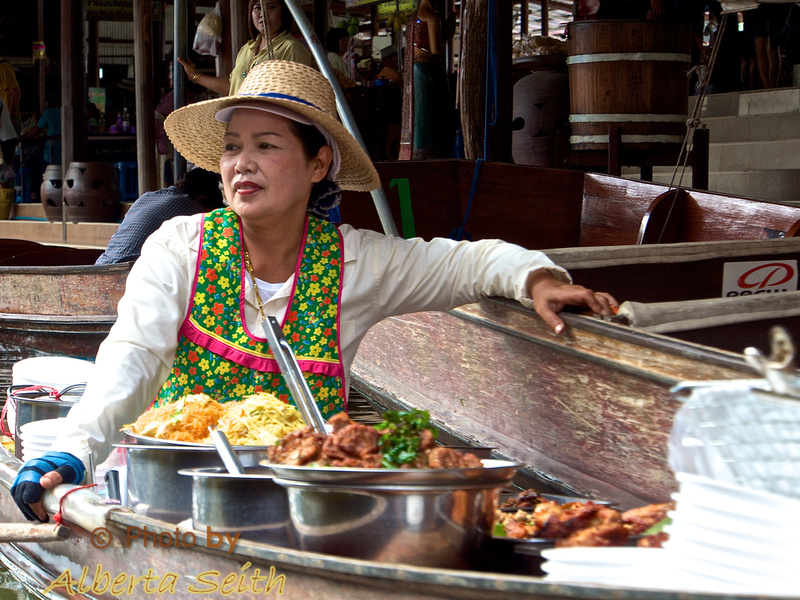 Vendor Cooking in Boat at the Floating Market