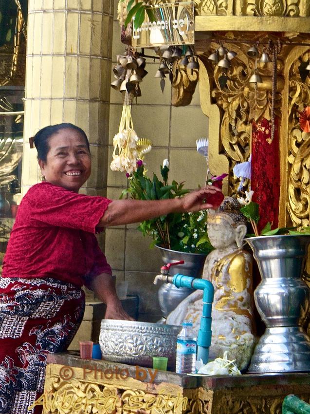 Worshiping at a Stupa at the Sule Pagoda